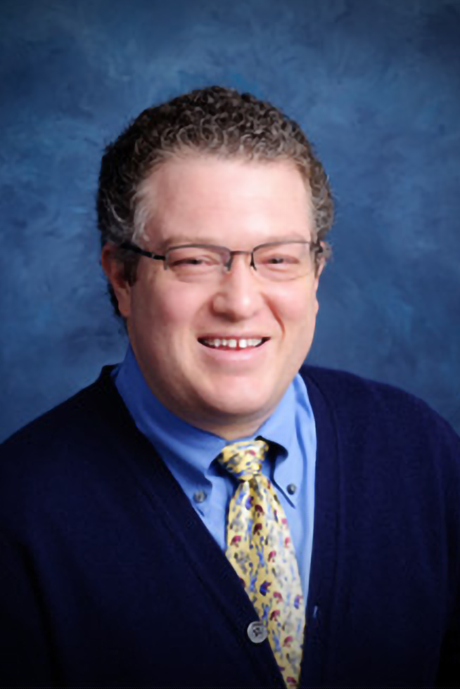 A portrait of Dr. Michael Joseph, the head of the Center for Pediatric and Adolescent Pain Care